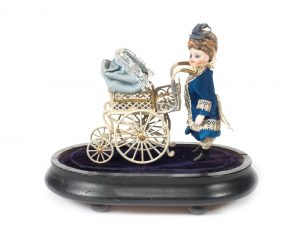 Miniature all-bisque doll with pram under glass dome