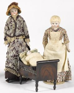 Rock & Graner painted tin crib with bisque doll house dolls